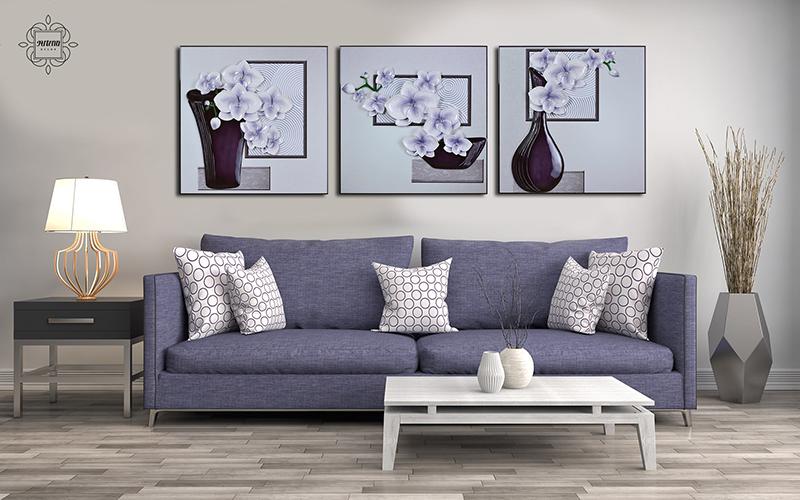 Tranh và ghế sofa là những vật trang trí không thể thiếu trong căn phòng rộng lớn