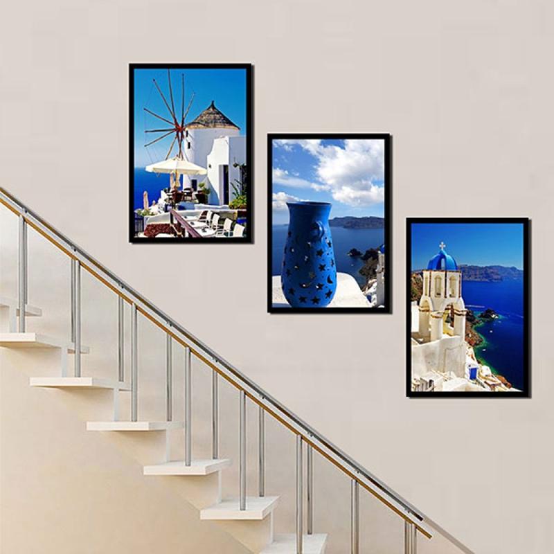 Phá cách với cách sắp xếp tranh dọc theo cầu thang